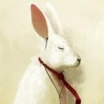 Белый заяц в красном галстуке с наушниками в ушах