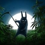 Кролик со злобным видом косит траву на фоне луны