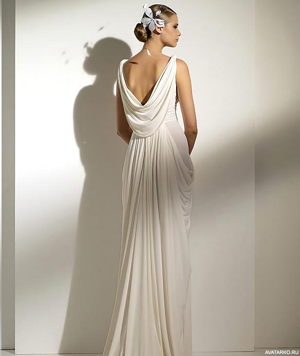 3a3dc43da7f Картинка девушки стоящей спиной в белом свадебном платье с цветком на голове
